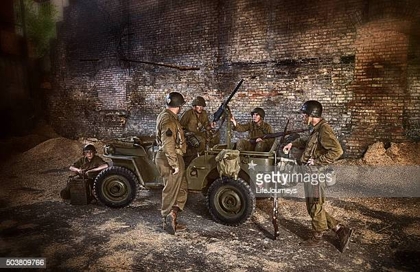 wwii us military squadron discussing military operation in abandoned building - artillery stock pictures, royalty-free photos & images
