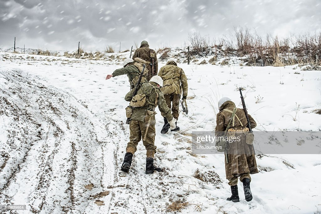 WWII US Military Squadron On Patrol In A Winter Blizzard : Stock Photo