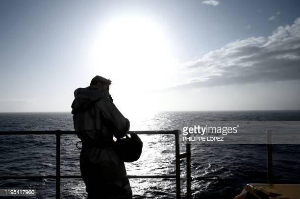 A military staff stands on the deck of the French aircraft carrier Charles de Gaulle at sea off the coast of the city of Hyeres on January 23 2020
