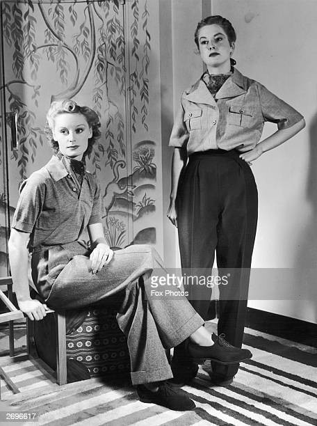 Military style woollen casual wear designed by Daks on show at Claridge's Hotel for the International Woold Secretariat On the left a grey wool...