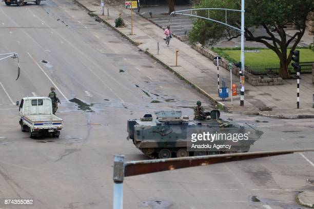 A military tank and a police truck seal off a main road to the presidential office within the military activities taking place in Harare Zimbabwe on...