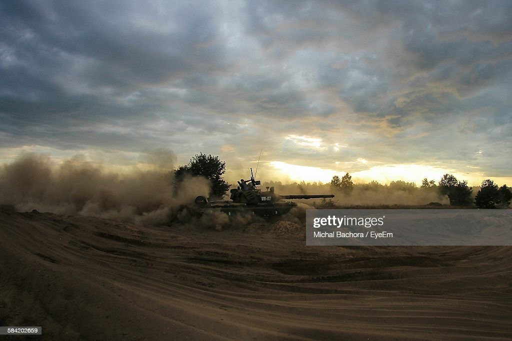 Military Tank On Field Against Sky During Sunset : Stock Photo