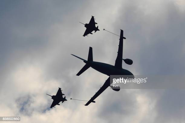 military tanker airplane and two fighter jets - military exercise stock pictures, royalty-free photos & images