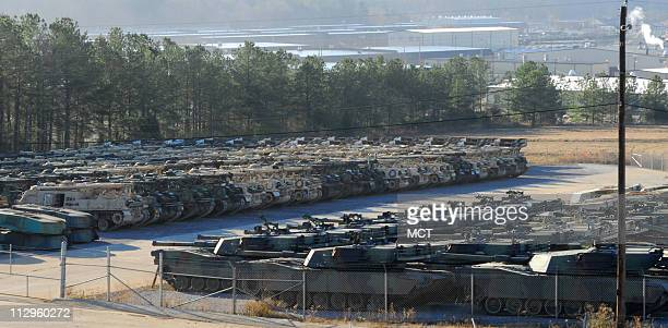US military tanks and other military heavy equipment sit in a storage yard on Tuesday December 5 at the Anniston Army Depot in Anniston Alabama where...