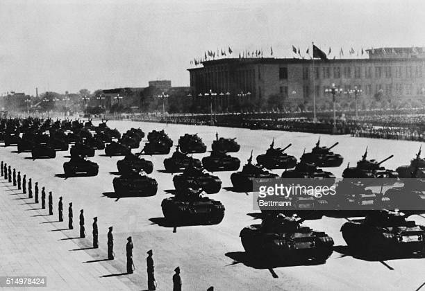 Military tanks and soldiers line up in Tiananmen Square during a military parade to mark the 19th anniversary of the regime