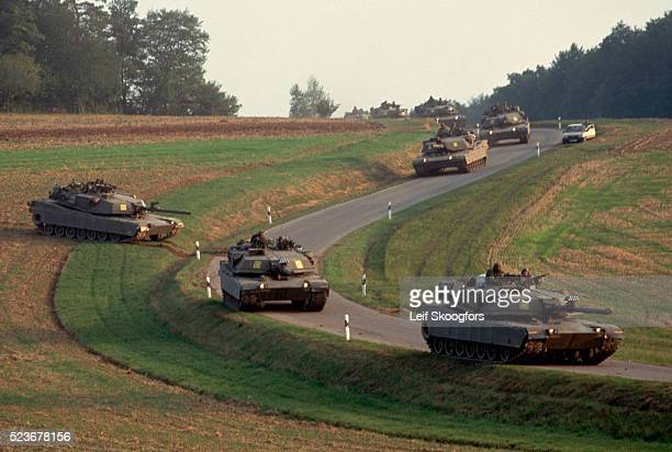 military tanks in german countryside - m1 abrams stock pictures, royalty-free photos & images