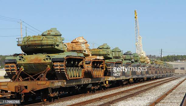 US military tanks sit on rail cars Tuesday December 5 waiting to be unloaded at the Anniston Army Depot in Anniston Alabama where they are overhauled...