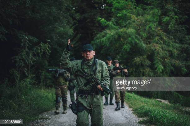 military team on duty - task force stock pictures, royalty-free photos & images