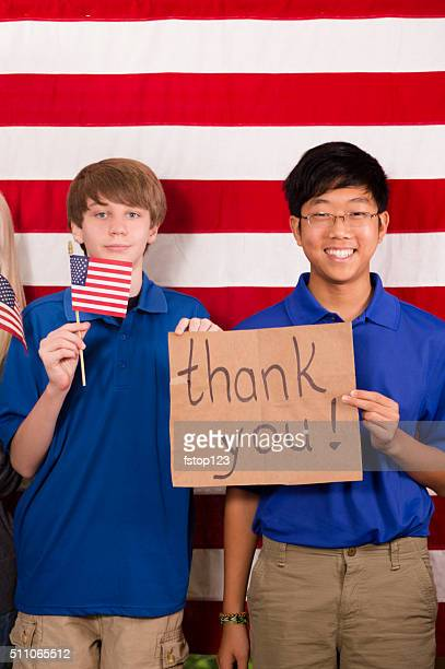 military:  teenage boys shows appreciation to veterans. usa flag. - thank you military veterans stock photos and pictures