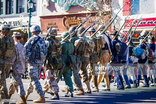 us military through the ages in veterans day parade - us army urban warfare stock photos and pictures
