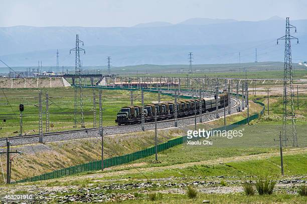 A military train heads to Xizang on Qingzang railway Qinghai Lakethe sacred lake of the Tibetan Buddhism is the largest salt lake in China people...