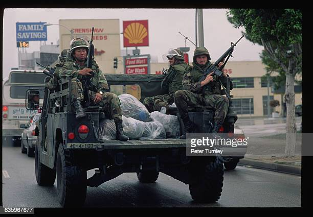 Military troops help restore order in Los Angeles after rioting occurred in the wake of the verdict in the Rodney King case.