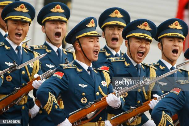 Military troops march during a welcoming ceremony for US President Donald Trump on November 9 2017 in Beijing China Trump is on a 10day trip to Asia