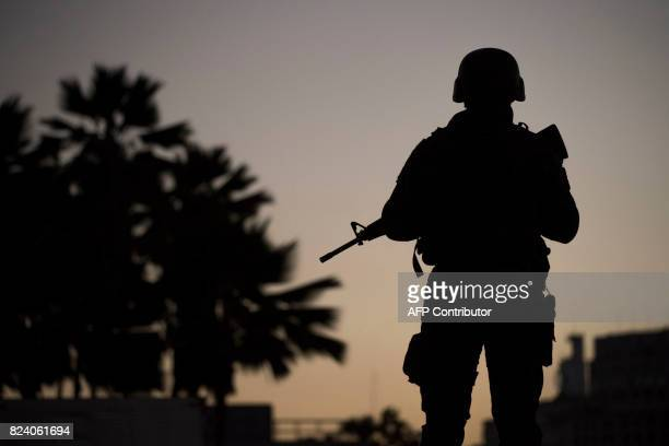 Military troops patrol the area around Santos Dumont airport in Rio de Janeiro Brazil on July 2017 Brazil has mobilized some 8500 soldiers to Rio de...