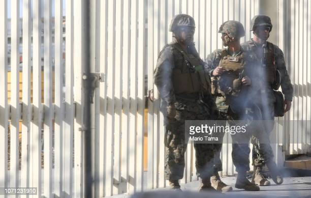S military troops stand on the US side of the San Ysidro port of entry during a largescale operational readiness exercise which briefly closed the...