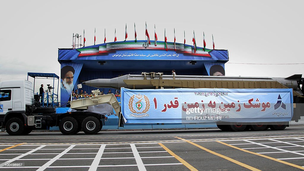 A military truck carries a long-range Ghadr-1 ballistic missile during the Army Day parade in the Iranian capital Tehran on April 18, 2010. President Mahmoud Ahmadinejad said that Israel was on its way to collapse, as Iran's military displayed a range of home-built drones and missiles at the annual Army Day parade.