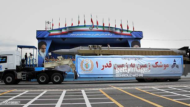 A military truck carries a longrange Ghadr1 ballistic missile during the Army Day parade in the Iranian capital Tehran on April 18 2010 President...