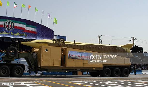 A military truck carries a longrange Iranian Shahab3 Ballistic missile during an annual military parade which marks Iran's eightyear war with Iraq in...