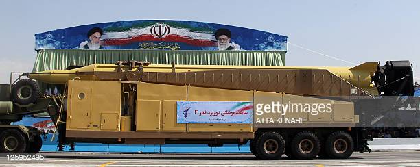 A military truck carries the longrange Khalij Fars a supersonic antiship ballistic missile during an annual military parade which marks Iran's...