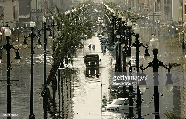 Military truck drives down a flooded Canal St. August 31, 2005 in New Orleans, Louisiana. Devastation is widespread throughout the city with water...