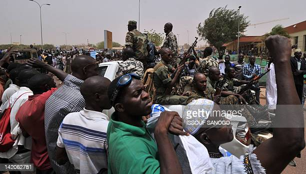 A military truck drives on March 29 2012 past Malian military junta supporters as coup leader Amadou Sanogo leaves Bamako airport A bid by west...
