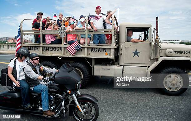A military truck painted with the words Make America Great Again and Trump 2016 drives along with Rolling Thunder bikers as they pass over Memorial...