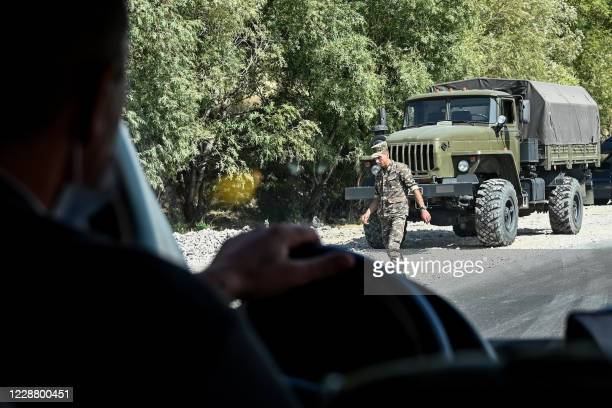 Military trucks are seen on the side of a road near the village of Zangakatun in Armenia on September 30, 2020. - Armenia and Azerbaijan rejected...