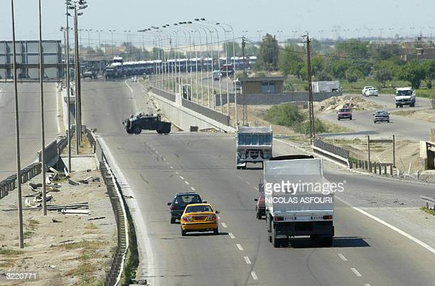 US military vehicle blocks the BaghdadAmman international highway 05 April 2004 due to ongoing military activities in the area home to the rebel...