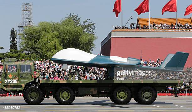 A military vehicle carrying a Pterodactyl I unmanned aerial vehicle drive past the Tiananmen Gate during a military parade to mark the 70th...