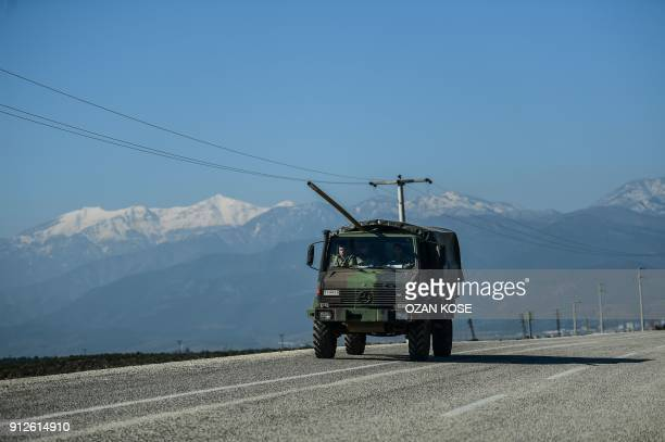 A military vehicle drives towards Kilis as it is dispatched to the TurkeySyria border on January 31 as part of the Turkish crossborder operation...