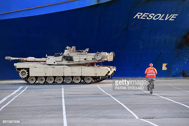 A US military vehicle is unloaded from a carrier ship in the harbour in Bremerhaven on January 6 2017 4000 US soldiers and about 2500 military...
