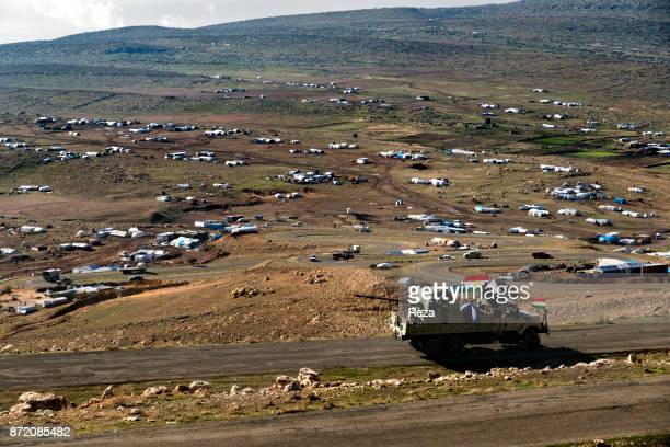 Military vehicle near by refugee tents. The town of Sinjar was liberated from ISIS on November 13th, 2015 by the Peshmerga forces of Iraqi Kurdistan....