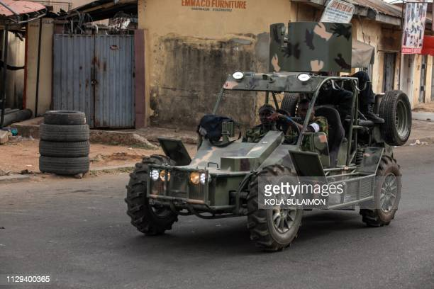 A military vehicle patrols the streets of Kaduna during Nigerias governorship and state assembly elections on March 9 2019 For the second time in a...