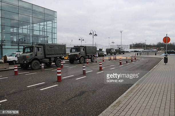 Military vehicles are parked, on March 23, 2016 at Liege airport, as extra security measures are being set one day after two massive suicide blasts...