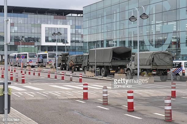 Military vehicles are parked outside Liege airport on March 23 as extra security measures are being set one day after two massive suicide blasts by...