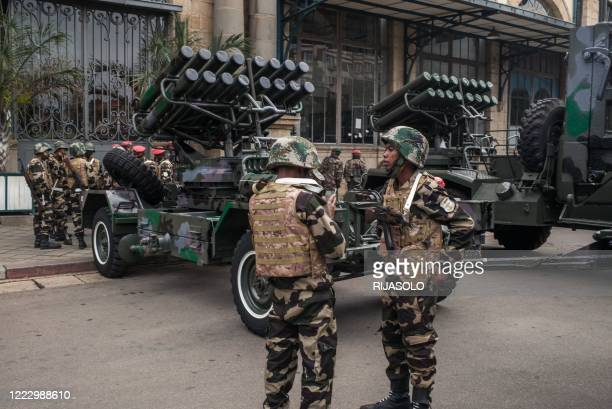 Military vehicles are positioned in downtown Antananarivo on June 26, 2020 before Malagasy military troops parade in front of the President of...