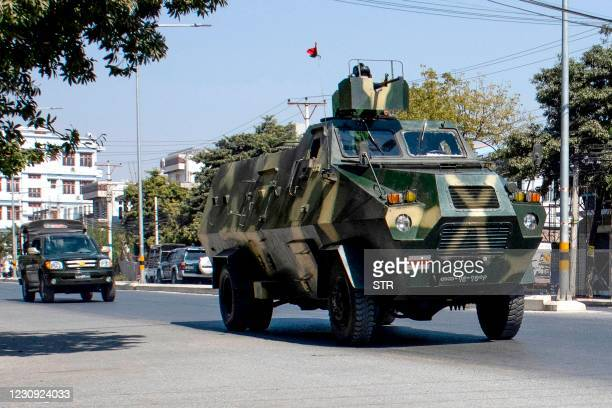 Military vehicles are seen along a street in Mandalay on February 2 as Myanmar's generals appeared in firm control a day after a surgical coup that...