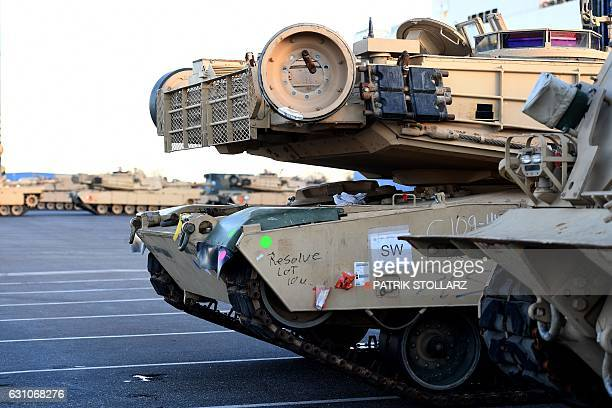 US Military vehicles are unloaded from a carrier ship in the harbour in Bremerhaven on January 6 2017 US soldiers and about 2500 military vehicles...