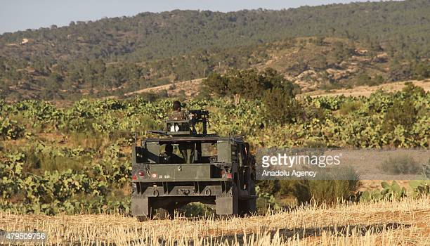 Military vehicles belonging to the Tunisian security forces are seen near Mount ElSelum as they carry out a military operation against possible...