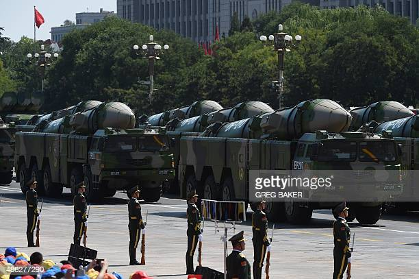 Military vehicles carrying DF21D missiles are displayed in a military parade at Tiananmen Square in Beijing on September 3 to mark the 70th...