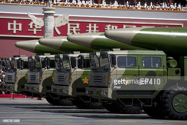 Military vehicles carrying DF-26 ballistic missiles, drive past the Tiananmen Gate during a military parade to mark the 70th anniversary of the end...