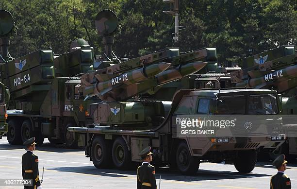 Military vehicles carrying HQ12 missiles are displayed in a military parade at Tiananmen Square in Beijing on September 3 to mark the 70th...