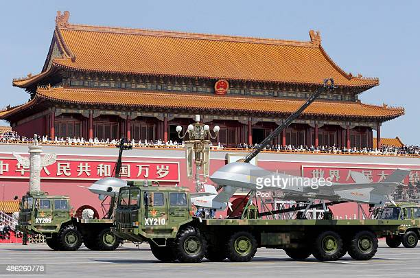 Military vehicles carrying Pterodactyl I unmanned aerial vehicles drive past the Tiananmen Gate during a military parade to mark the 70th anniversary...