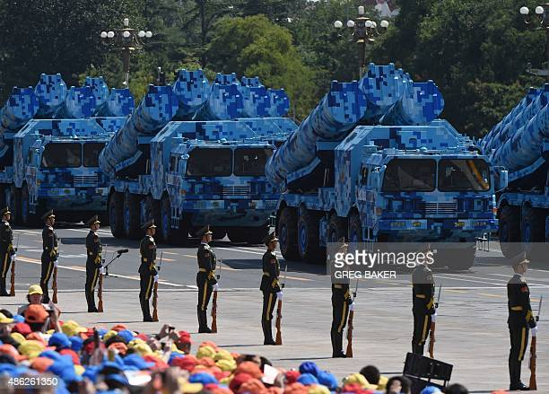 Military vehicles carrying shoretoship missiles participate in a military parade at Tiananmen Square in Beijing on September 3 to mark the 70th...