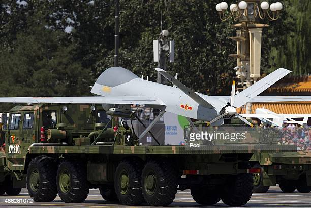 Military vehicles carrying Wing Loong a Chinese made medium altitude long endurance unmanned aerial vehicles drive past the Tiananmen Gate during a...