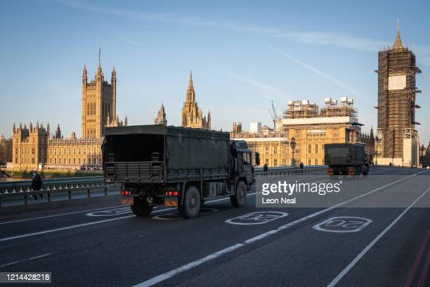 Military vehicles cross Westminster Bridge after members of the 101 Logistic Brigade of the British Army delivered a consignment of medical masks to...