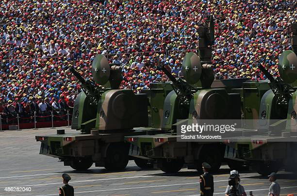 Military vehicles drive past the Tiananmen Gate during a military parade to mark the 70th anniversary of the end of World War Two on September 3,...