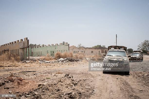 Military vehicles leave the grounds of the Government Girls Secondary School Chibok in Borno State north-eastern Nigeria on March 25, 2016. There's...