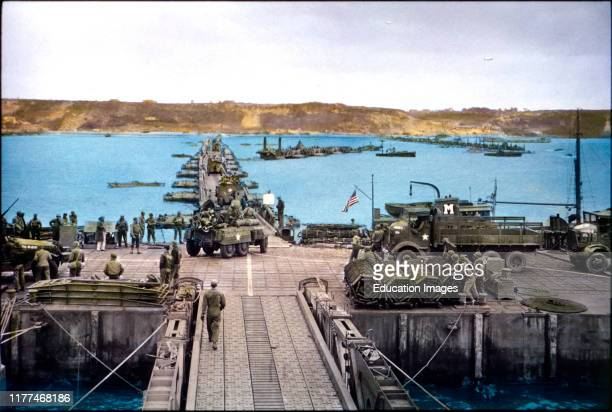 Military Vehicles move ashore across Pontoon Bridge to Omaha Beach from Temporary Mulberry Harbor A, Normandy, France, June 16, 1944.