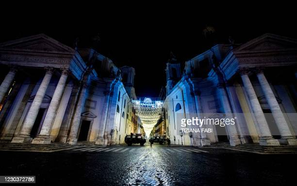 Military vehicles patrol on Piazza del Popolo in central Rome on December 31 during New Year's Eve as a 10:00 pm-7:00 am curfew is implemented in...
